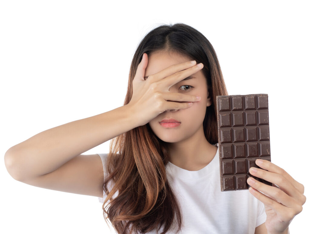 Women who are against chocolate,isolated on a white background.